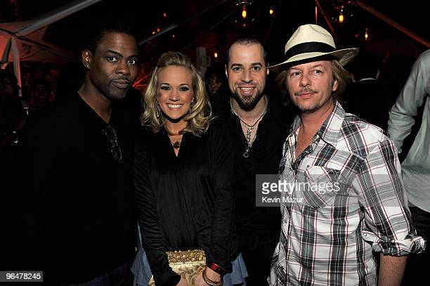 MIAMI BEACH FL FEBRUARY 06 Comedian Chris Rock Musician Carrie Underwood Musician Chris Daughtry and Comedian David Spade attend the Super Bowl Party...