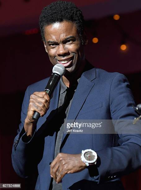 Comedian Chris Rock speaks onstage during Madonna presents An Evening of Music Art Mischief and Performance to benefit Raising Malawi at Faena Forum...