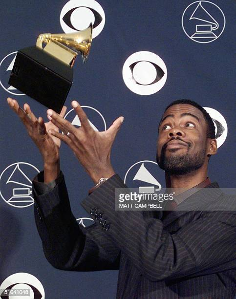 Comedian Chris Rock throws his Grammy Award in the air 25 February in New York Rock was awarded the Best Spoken Comedy Album for 'Roll With The New'...