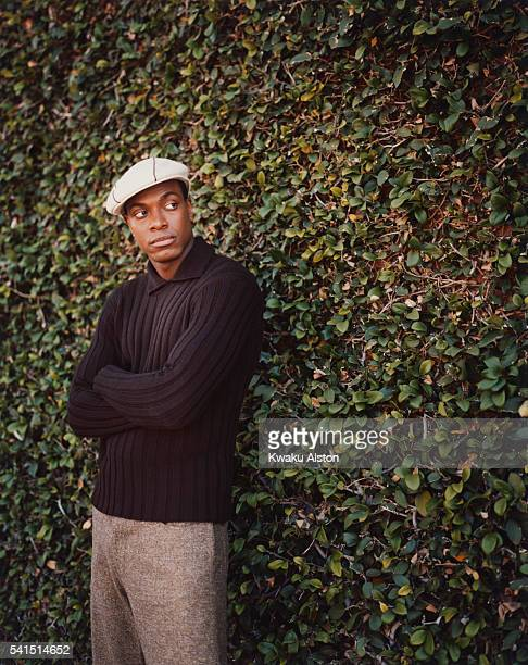 Comedian Chris Tucker Next to Plant Coverd Wall