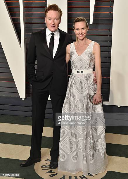 Comedian Conan O'Brien and Liza Powel arrive at the 2016 Vanity Fair Oscar Party Hosted By Graydon Carter at Wallis Annenberg Center for the...