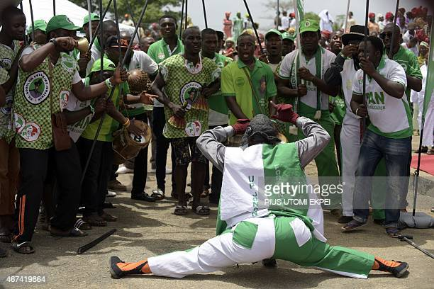 A comedian dances on March 24 2015 during a rally to mobilize support for the reelection of Nigerian President Goodluck Jonathan and candidate of the...