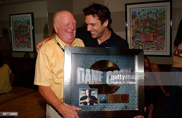 Comedian Dane Cook and his father George Cook celebrate Dane Cook's gold record at the Madison Square Garden Theater on September 17 2005 in New York...