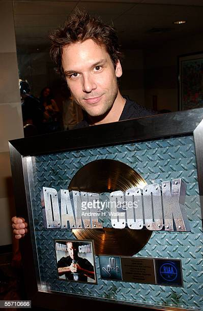 Comedian Dane Cook celebrates receiving a gold record at the Madison Square Garden Theater on September 17 2005 in New York City