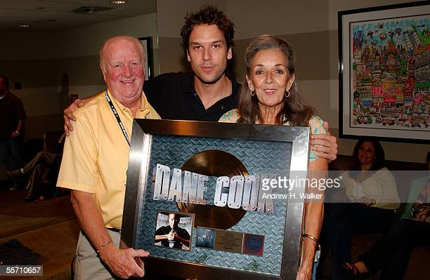 Comedian Dane Cook celebrates receiving a gold record with his parents George and Donna Cook at the Madison Square Garden Theater on September 17...
