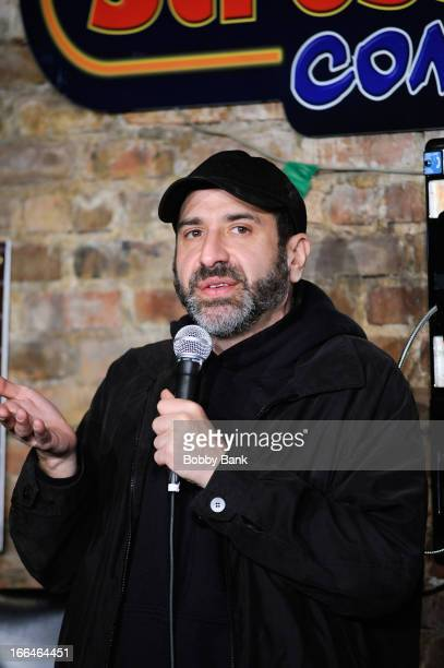 Comedian Dave Attell performs at The Stress Factory Comedy Club on April 12, 2013 in New Brunswick, New Jersey.