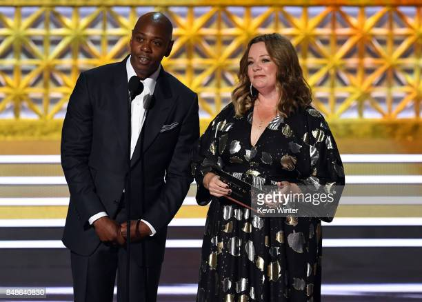 Comedian Dave Chappelle and actor Melissa McCarthy speak onstage during the 69th Annual Primetime Emmy Awards at Microsoft Theater on September 17...