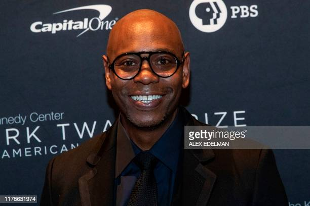 Comedian Dave Chappelle and recipient of the Mark Twain Award for American Humor arrives at the Kennedy Center for award ceremony on October 27, 2019...
