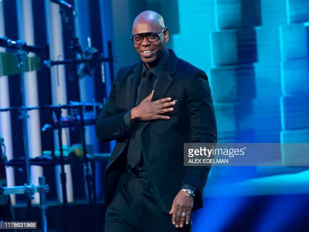 Comedian Dave Chappelle arrives on stage at the Kennedy Center for the Mark Twain Award for American Humor on October 27, 2019 in Washington, DC. -...