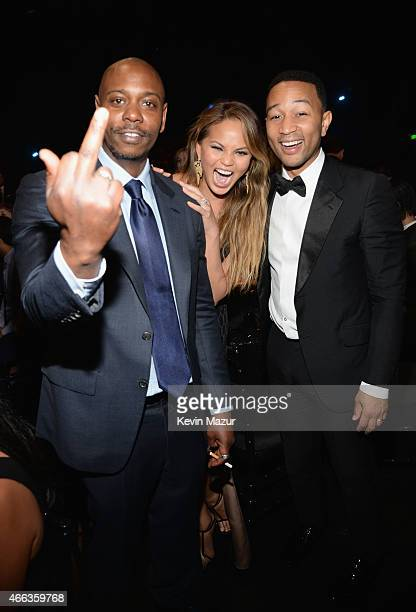 Comedian Dave Chappelle model Chrissy Teigen and recording artist John Legend attend The Comedy Central Roast of Justin Bieber at Sony Pictures...