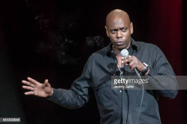Comedian Dave Chappelle performs at Xfinity Theatre August 23 2014 in Hartford Connecticut