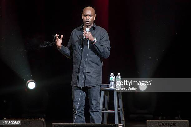 Comedian Dave Chappelle performs at Xfinity Theatre August 23, 2014 in Hartford, Connecticut.