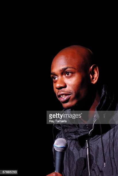 Comedian Dave Chappelle performs during The Roots concert at Radio City Music Hall on May 19, 2006 in New York City.