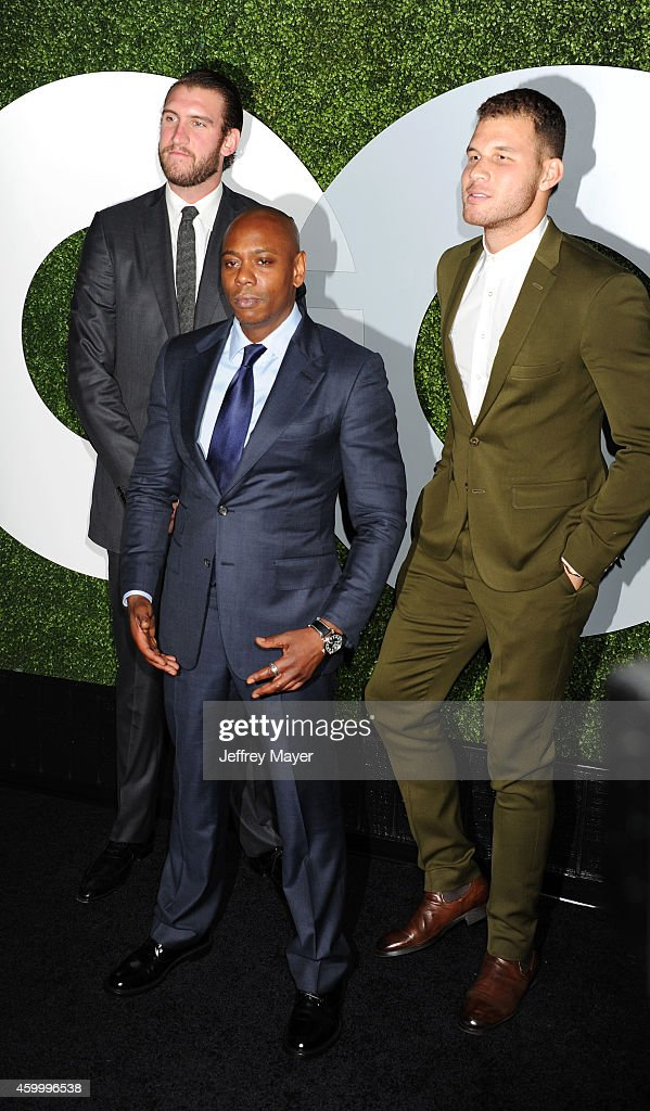 Comedian Dave Chappelle (C) poses with NBA players Spencer Hawes (L) and Blake Griffin (R) at the 2014 GQ Men Of The Year Party at Chateau Marmont on December 4, 2014 in Los Angeles, California.