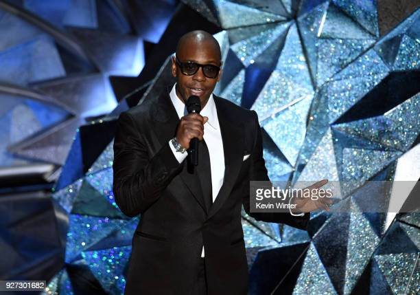 Comedian Dave Chappelle speaks onstage during the 90th Annual Academy Awards at the Dolby Theatre at Hollywood Highland Center on March 4 2018 in...