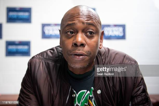 Comedian Dave Chappelle talks with the media while campaigning for Democratic presidential candidate Andrew Yang on January 30, 2020 in North...