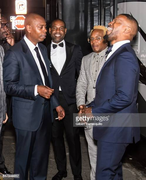 Comedian Dave Chappelle Unik Ernest and actor Jamie Foxx are seen during Rihanna's 3rd Annual Diamond Ball Benefitting The Clara Lionel Foundation at...