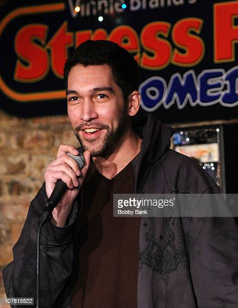 Comedian Dave Smith performs at The Stress Factory Comedy Club on December 29, 2010 in New Brunswick, New Jersey.