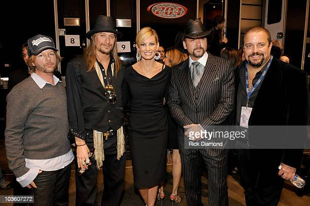 Comedian David Spade with musicians Kid Rock, Faith Hill, Tim McGraw and Raul Malo backstage at the 2009 MusiCares Person of the Year Tribute to Neil...