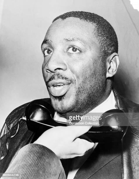 Comedian Dick Gregory interviewed on the telephone in 1964