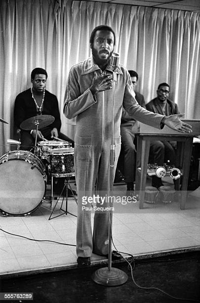 Comedian Dick Gregory performs at the microphone for his fellow prisoners at Cook County Jail Chicago Illinois 1969