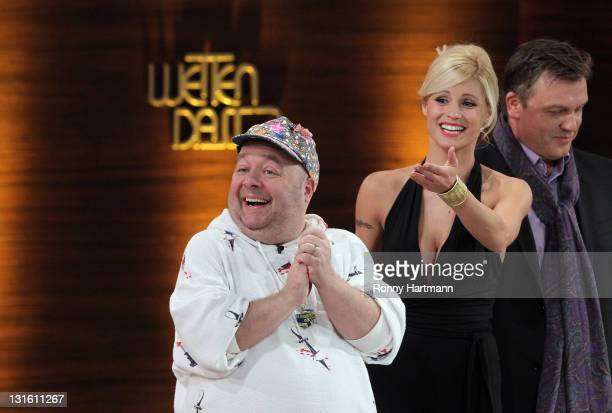 Comedian Dirk Bach TV host Michelle Hunziker and TV host Hape Kerkeling attend the 198th 'Wetten dass ' show at Messe Leipzig on November 5 2011 in...
