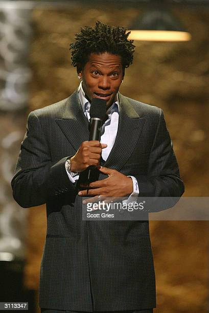 Comedian DL Hughley performs at the Comedy Central Bar Mitzvah Bash in the Hammerstein Ballroom at Manhattan Center Studios March 19 2004 in New York...
