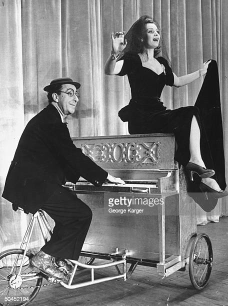 Comedian Ed Wynn and Jane Pickens performing in a scene from the play Boys and Girls Together