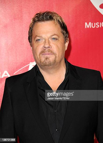 Comedian Eddie Izzard arrives at the 2012 MusiCares Person of the Year Tribute To Paul McCartney held at the Los Angeles Convention Center on...