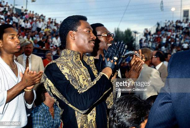 Comedian Eddie Murphy and his brother Charlie Murphy attend Thomas Hearns versus James Shuler fight at Caesar's Palace on March 10 1986 in Las Vegas...