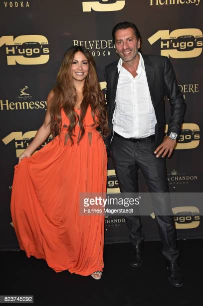 Comedian Enissa Amani and Ugo Crocamo during the H'ugo's 10th birthday celebration party at Hugo's on July 27, 2017 in Munich, Germany.