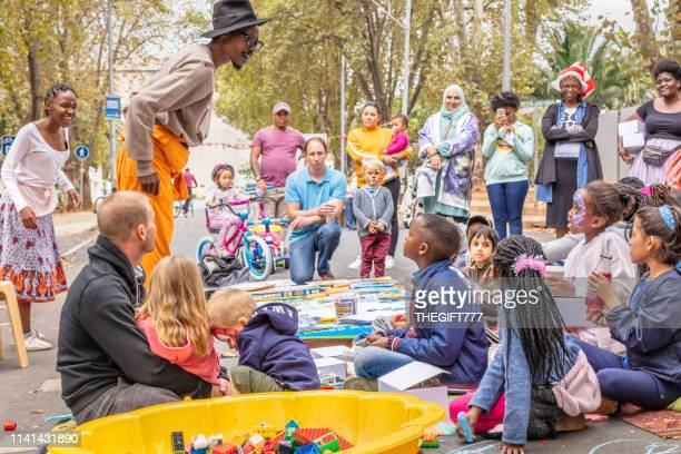 comedian entertaining the children in the streets - gauteng province stock pictures, royalty-free photos & images