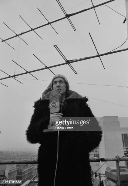 Comedian Eric Idle performing on the roof of BBC Broadcasting House for the BBC radio special 'Radio 5 with Eric Idle', London, March 5th 1974.