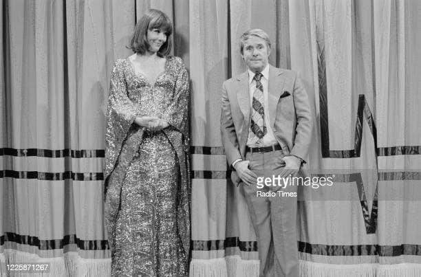 Comedian Ernie Wise in a sketch with actress Diana Rigg for the Christmas special of the BBC television series 'The Morecambe and Wise Show', 1975.