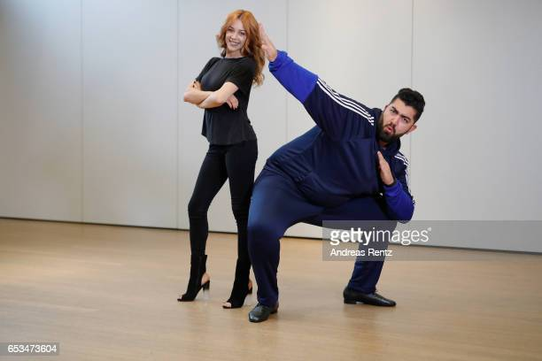 Comedian Faisal Kawusi and Oana Nechiti pose at a photo call for the tenth season of the television competition 'Let's Dance' on March 15 2017 in...