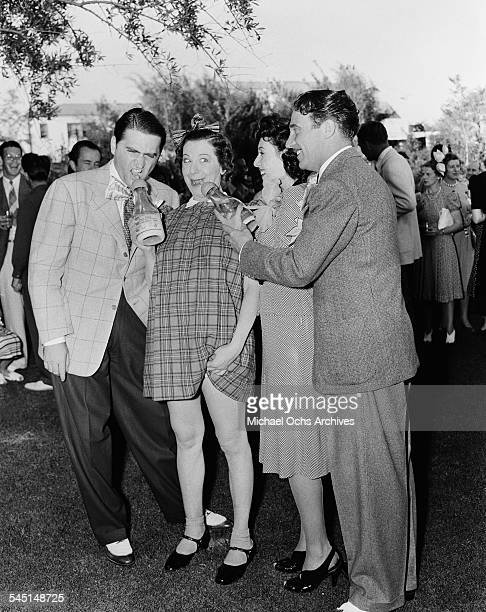 Comedian Fanny Brice clowns around with friends during her birthday party in Los Angeles California
