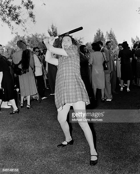 Comedian Fanny Brice poses with bat at her birthday party in Los Angeles California