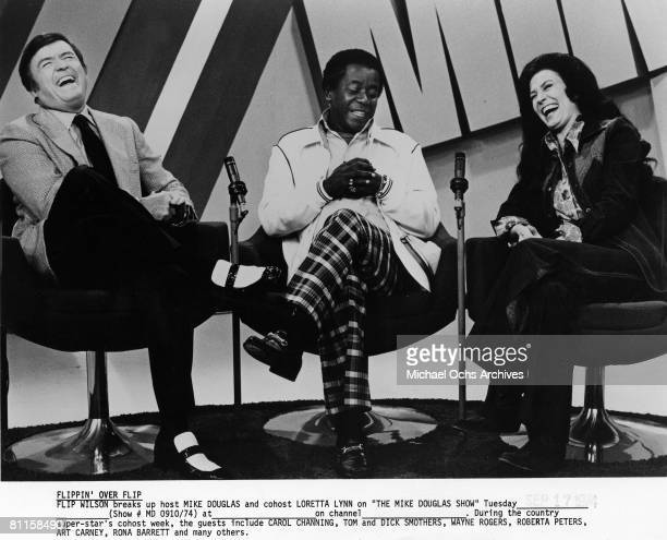 Comedian Flip Wilson and country singer join Mike Douglas on 'The Mike Douglas Show' in 1974 in Los Angeles California