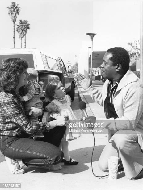 Comedian Flip Wilson conducts onthestreet interviews with people of all ages on the TV show People Are Funny on March 16 1984