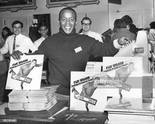 Comedian Flip Wilson making an in store appearance at E J Korvette on 5th Avenue to promote his album Cowboys And Colored People in 1968 in New York...