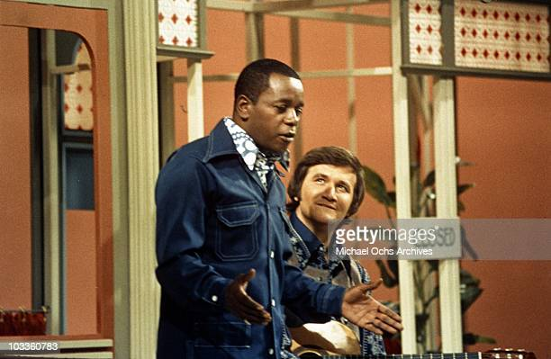 Comedian Flip Wilson sings with a man in a scene from the Flip Wilson Show in circa 1972