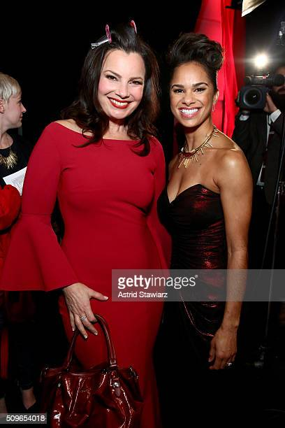 Comedian Fran Drescher and ballerina Misty Copeland pose backstage at The American Heart Association's Go Red For Women Red Dress Collection 2016...