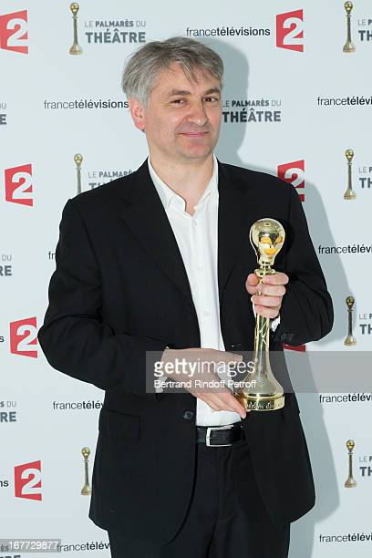 """Comedian Francois Loriquet poses with his Best Supporting Male Comedian award for """"Les Revenants"""" during the 'Palmares Du Theatre 2013' award..."""