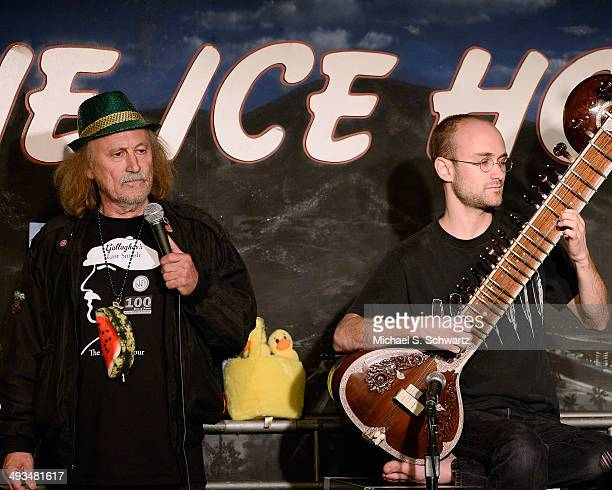 Comedian Gallagher performs with his son Barnaby Gallagher during their appearance at The Ice House Comedy Club on May 23 2014 in Pasadena California