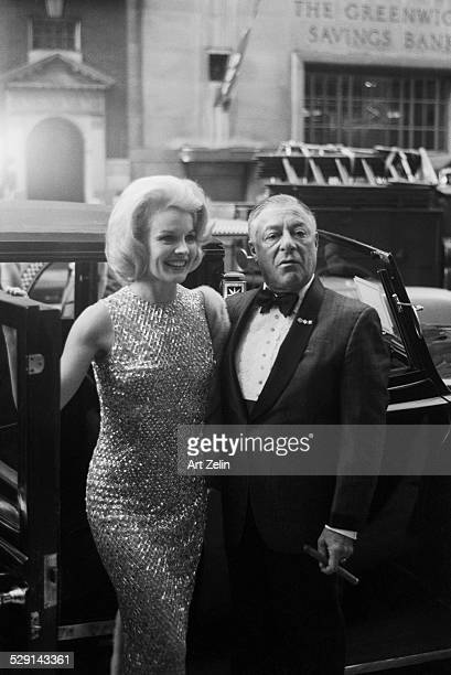 Comedian George Jessell with actress Carol Baker getting out of a limousine circa 1970 New York