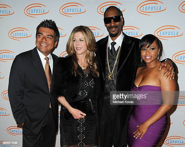 Comedian George Lopez actress Rita Wilson musician Snoop Dogg and Shante Broadus arrive at the 10th Annual Lupus LA Orange Ball at the Beverly...