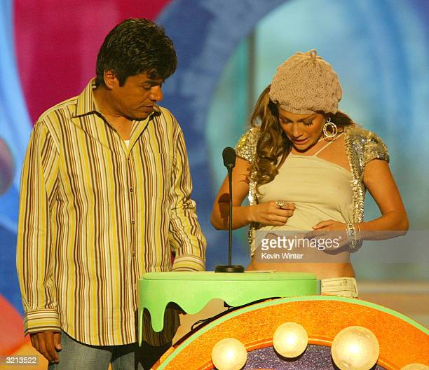 Comedian George Lopez and actress/musician Jennifer Lopez present an award during Nickelodeon's 17th Annual Kids' Choice Awards at Pauley Pavilion on...