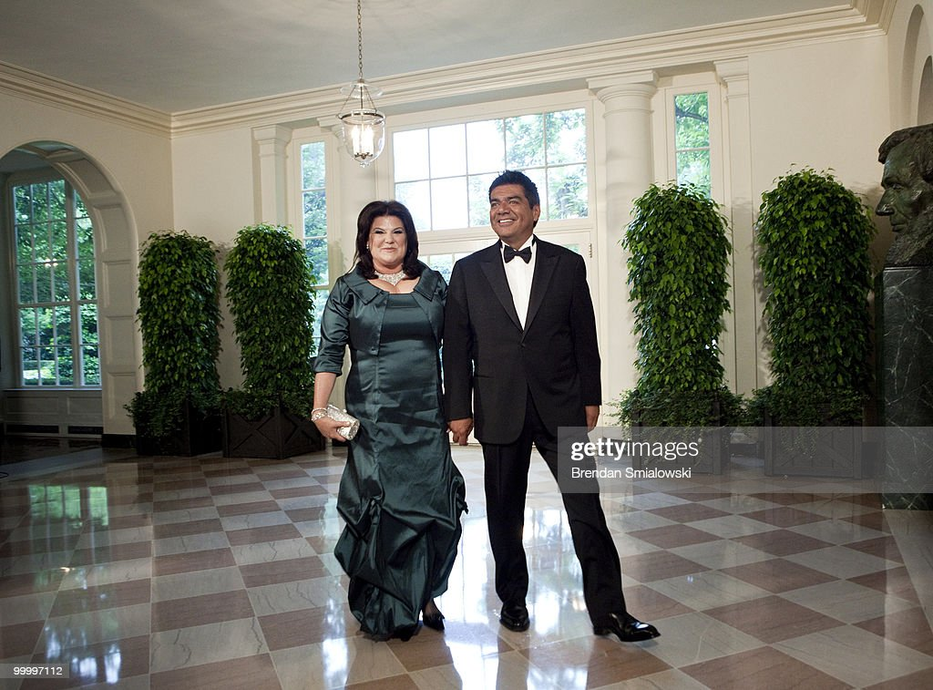 Comedian George Lopez (R) and Ann M. Lopez arrive at the White House for a state dinner May 19, 2010 in Washington, DC. President Barack Obama and first lady Michelle Obama are hosting Mexican President Felipe Calderon and his wife Margarita Zavala for a state dinner during their visit to the United States.