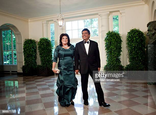 Comedian George Lopez and Ann M Lopez arrive at the White House for a state dinner May 19 2010 in Washington DC President Barack Obama and first lady...