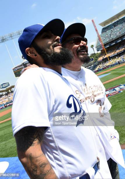 Comedian George Lopez and Los Angeles Dodgers Pitcher Sergio Romo during an MLB opening day game between the San Diego Padres and the Los Angeles...